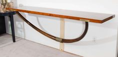 A Midcentury Maurice Bailey for Monteverdi Young Wall Mounted Console Table | From a unique collection of antique and modern console tables at https://www.1stdibs.com/furniture/tables/console-tables/