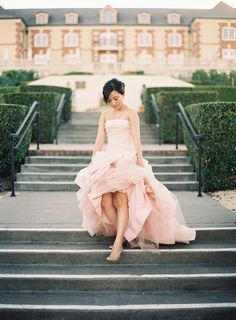 A bride regally descends outdoor stairs in her blush Vera Wang gown. #Weddings