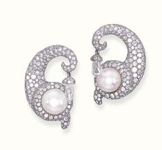 A PAIR OF DIAMOND AND PEARL EAR PENDANTS, BY JAR  Each designed as a pavé-set diamond cornucopia, with a central pearl, suspending a briolette-cut diamond drop, mounted in silver and gold, with French assay marks for gold, in a JAR pink leather case Signed JAR, Paris. With certificate 39998 dated 19 September 2002 from the SSEF Swiss Gemmological Institute stating that the pearls are natural saltwater pearls