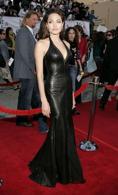 Jolie was a total knockout in this leather halter bustier gown at the Mr. and Mrs. Smith premiere.   - MarieClaire.com