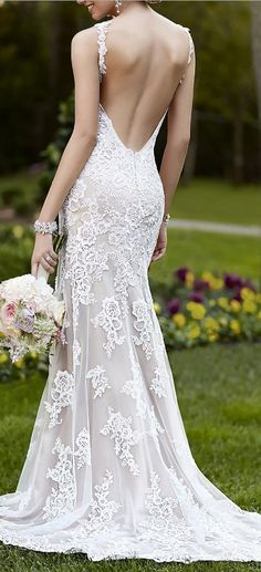 Ideal for a garden or beach wedding. This Lace over Lustre Satin sheath Wedding Dress features gorgeous vine shoulder straps, a low back with a zipper closure, and a sweep train. You'll love how the Lace embroidered bodice hugs your curves, while the V-neckline frames your face.