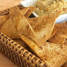 """Baked Tortilla Chips   """"Tasty baked tortilla chips you make at home that are much better than store bought chips. Serve with your choice of salsas and garnishes."""""""