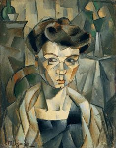 "Inspired by the work of Paul Cezanne, Jean Metzinger painted this affectionate ""Portrait of Madame Metzinger,"" 1911, with a muted palette that helped emphasize her prominent pompadour and wary look. Philadelphia Museum of Art."