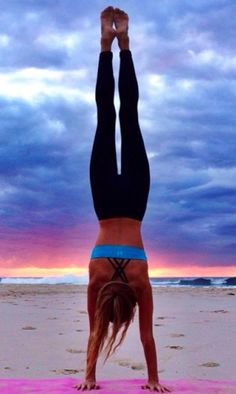 The sky is so beautiful in this beach yoga picture