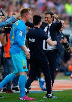 Luis Enrique manager of Barcelona celebrates with players and staff as they win the title after the La Liga match between Club Atletico de Madrid and FC Barcelona at Vicente Calderon Stadium on May 17, 2015 in Madrid, Spain. Barcelona are champions after a 1-0 victory.