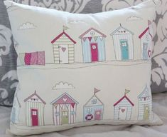 Fryetts -  Fryetts Fabric Collection - Shades of cream, pink, light blue, white and green making up a fun beach hut design on a square scatter cushion