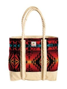 """Maize Spirit Surf Tote Rugged and retro, our wool bag has a canvas lining and cotton rope handles. Exclusive Maize Spirit pattern is a Native American-inspired design honoring the Lakota corn legend. Vintage-style surf label features Haystack Rock off the Oregon coast. Wool fabric is woven in our American mills. Pattern placement varies. 14""""H x 15""""L x 6""""W 100% pure virgin wool exterior Canvas lining"""