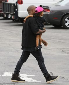 His Only One: Kanye West was also spotted arriving with his daughter North West...