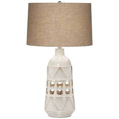 A fresh take on tribal style, this contemporary ceramic night light table lamp features cut-out circles and a warm burlap shade.