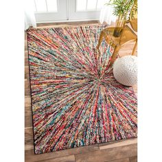 Soft and plush, the pile on this contemporary area rug is made from 100% polypropylene to prevent shedding, and will tie together any fashionable space. Add a sense of retro flair to any living room w