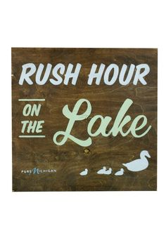 Rush hour isn't so bad when spent on the lake! This Pure Michigan sign would be perfect for your home or cabin. As an added bonus, it's hand painted by a local artist!