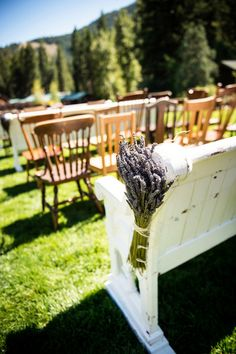 Rustic wedding ceremony aisle markers - bunches of lavender on vintage white benches {Lauren Brown Photography}