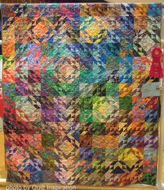 """Batik North Wind, 68 x 78"""", by Alice Morgan, quilted by Janell Dobbs.  2014 RCQG.  Photo by Quilt Inspiration"""