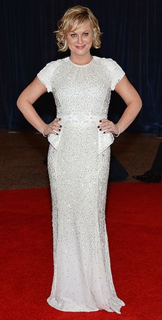 Amy Poehler wore a white beaded peplum dress by Brian Rennie for Basler