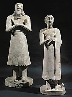 Gypsum Statuettes of a man and a woman, from Nippur, Temple of Ianna, Baghdad, Iraq Museum, c. 2400 BC.