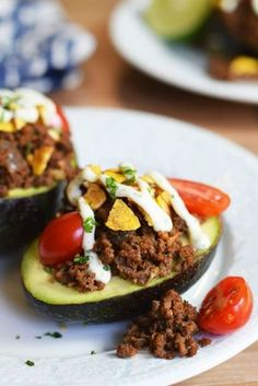 Taco Stuffed Avocados with Creamy Cilantro Lime Dressing - Top with your favorite fresh taco veggies and just a drizzle of dressing - serves 4 for breakfast, lunch or dinner!