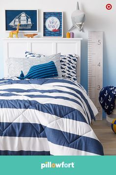 Make sure your kiddo's bedroom is ready to set sail in style with Pillowfort's Ocean Oasis collection. A blue-and-white striped duvet is classic enough to grow with them, while the shark-print sheet set and octopus friend adds a little wild whimsy.
