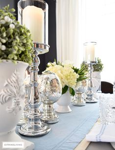 Silver candle holders, mercury glass accessories, topiaries and a white hydrangea arrangement are elegant and sophisticated for Easter and Spring tablescapes. Table Centerpieces, Table Decorations, Elegant Centerpieces, Silver Candle Holders, Hydrangea Arrangements, Dinning Table, Dining Room, Fall Table, Dinners For Kids