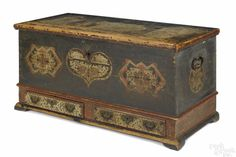 """Lancaster County, Pennsylvania """"Embroidery Artist"""" painted pine dower chest, dated 1785, inscribed Catrina Bhilivin, the lid and front with three tulip panels on a blue ground, flanked by sides with large stars, above two ivory drawers with salmon surrounds, 25"""" h., 50"""" w., sold for 15,600.00, est. 4-8000."""