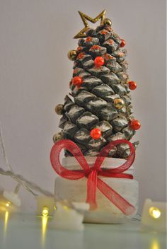 A DIY christmas pinecone tree made with some beads I had on my hobby shelf and some white washable paint!