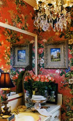 <3 rich floral wallpaper and chandelier in this tiny bathroom