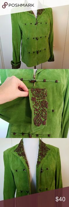"""100% Suede jacket w/ wood beadwork Bright Apple green suede jacket has wooden bead work across collar & cuffs w/vertical slit pockets. Intricate work is accentuated by wood toggle/frog closures that close over the zip front.   Great shape, no stains, damage. A few small beads are missing on the collar (see last pic) but difficult to spot. Beading extends down collar to the inside of the jacket. I think any of these could be """"harvested"""" to use as replacements if desired.Color may appear…"""
