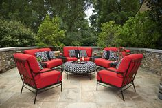 The bright red and black and white patterns work so well with these outdoor pieces! #miskellys #outdoorfurniture