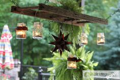 Ladder and mason jar lighting by Unskinny Boppy featured on Funky Junk Interiors