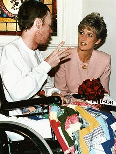 TORONTO  Diana – who helped reduce the stigma associated with HIV/AIDS when she was photographed shaking hands with a patient in 1987 – remained active in the fight against the disease. Here, she talks with AIDS patient Wayne Taylor at the Casey House AIDS hospice in 1991.