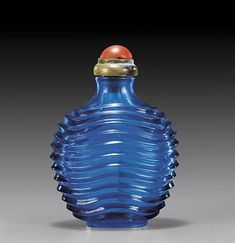 finely carved blue waves glass snuff bottle