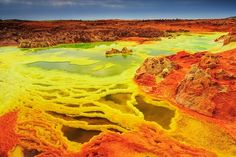 Dallol Volcano - Photo by Yi Sun, taken 1-2-16 - Dallol is a volcanic explosion crater in the Danakil Depression in Ethiopia. The Dallol Volcano has the most colorful geothermal field filled with Sulphuric acid pools. It is the hottest place on earth with average annual temperature of over 30oC. These craters are the lowest known subaerial volcanic vents in the world, at over 45 m (150 ft) below sea level. - National Geographic Your Shot