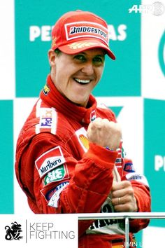 Michael during the race and on the podium after his victory at the Malaysian GP 18/3/2001  #KeepFighting #TeamMichael