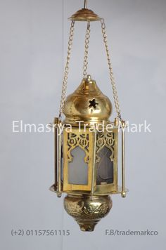 Moroccan Style Brass Lantern - With Multiple Color Glass - # CH-108  The weight is 0.60 KG approximately. The height is 30cm – without chain - and with chain is 40cm and 15cm width approximately. The Brass Lantern Handmade in Egypt, the Lantern body is 100% made of Brass With  Multiple Color Glass , it can be used in the entryways, or empty corners. it cast a magical and exotic effect during the night and exude elegance and beauty during the day! It adds a uniquely foreign touch to your…