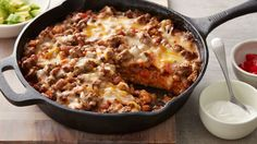 Enchiladas meet cornbread in this incredible new flavor-packed skillet dinner. It all starts with a cheesy cornbread base that's infused with enchilada sauce, then layered with seasoned beef and beans, and piled high with fresh toppings.