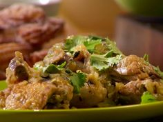 Braised Chicken with Tomatillos and Jalapenos from FoodNetwork.com by Anne Burrell - goes great over rice and garlic cilantro black beans