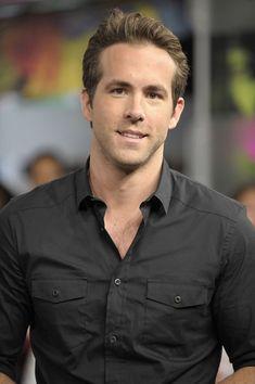 Ryan Reynolds in black double pockets shirt