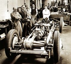 Malcolm Campbell (second L) and his team with Napier-Campbell Bluebird, minus it's bodywork - UK - 12 January 1931