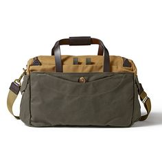 The Heritage Sportsman Bag from Filson.  Note leather tabs at the terminus of the zipper.  Would not bother with an outside pocket on the side of the bag.