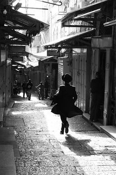 A Jewish Orthodox man in a hurry among the backstreets of Old Jerusalem