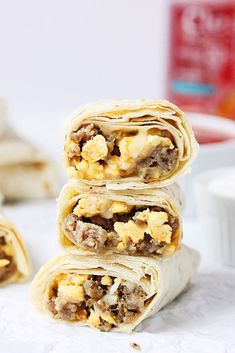 These make-ahead freezer breakfast burritos are kid tested and approved! Less than 20 minutes to prep and less than 3 minutes to reheat. Nothing like a yummy, quick, on-the-go breakfast!