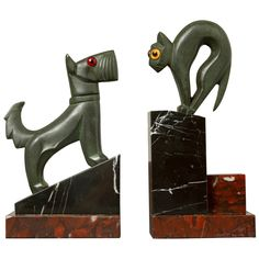 Art Deco Pair of Cat and Dog Bookends | From a unique collection of antique and modern bookends at https://www.1stdibs.com/furniture/more-furniture-collectibles/bookends/