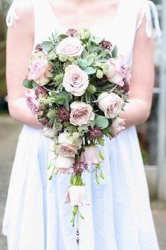 Bouquet of vintage roses, eryngium, astrantia,eucalyptus, dendrobium orchids and beads.