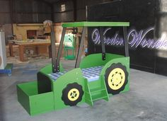 Image detail for -I'm pretty sure there wouldn't be any tears before bedtime if tractor-mad kids had this to climb into. They'd be begging for lights out. This bed is the handiwork of ...