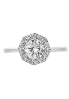 Inspired from a traditional halo, your center stone takes on a new dimension with .10 ct tw diamond octogan shaped halo. Simple and elegant, this ring speaks for itself. A matching diamond band tucks under the ring to sit next to the ring. Available in platinum, white gold, yellow gold, and rose gold.