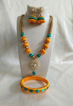 Buy silk thread bangles new design, silk thread necklace, silk thread earrings and jhumkas online. Customized Silk Thread jewellery set at best affordable prices for women's jewellery shopping online. Silk Thread Earrings Designs, Silk Thread Bangles Design, Silk Thread Necklace, Silk Bangles, Thread Jewellery, Silk Thread Jhumkas, Beaded Jewellery, Textile Jewelry, Jewellery Making