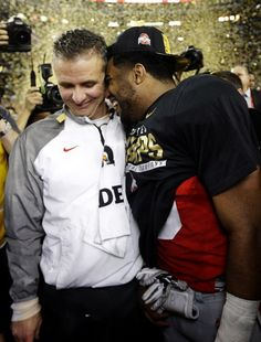 CORRECTS PLAYER AT RIGHT  TO EZEKIEL ELLIOTT- Ohio State head coach Urban Meyer and Ezekiel Elliott celebrate after the NCAA college football playoff championship game against Oregon Monday, Jan. 12, 2015, in Arlington, Texas. Ohio State won 42-20. (AP Photo/David J. Phillip)