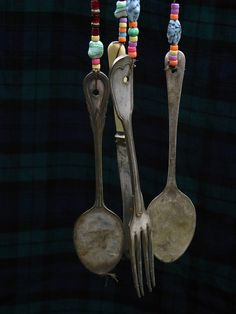 Garden wind chimes out of old cutlery --- used to have one... miss it so i think i need to make me one.. and twirl the fork tines
