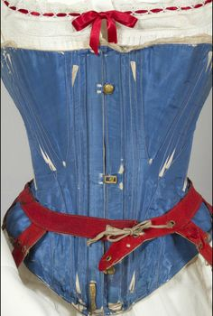 1860s blue silk satin corset with white flossing. Powerhouse Museum (Australia), but purchased in England.