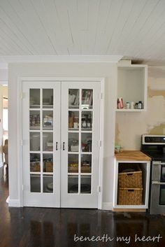 My pantry will look like this after I'm done with it.... Bye bye plain white doors!!