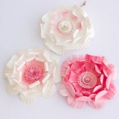 These paper plate flowers are a beautiful and frugal craft! Great bridal shower or spring party decor.